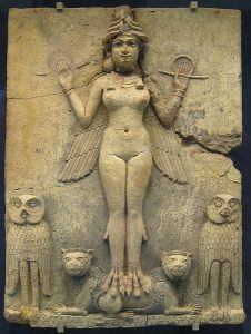 A talloned and wing goddess stands atop cats and between owls.
